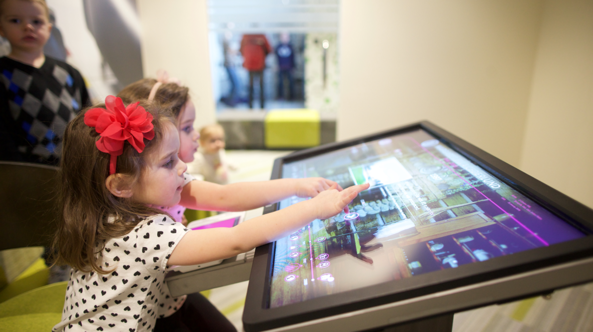 Two children explore the family's history in The Time Machine at the Family History Library in Salt Lake City, Utah.