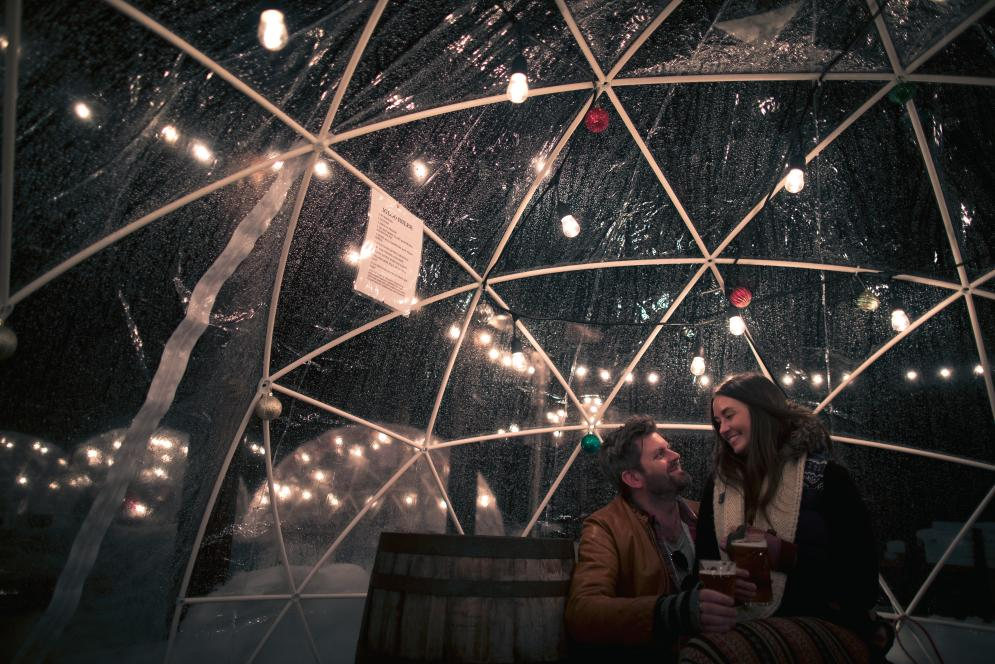 Couple in Hop lot Igloos