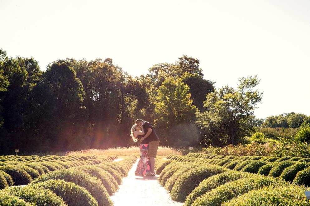 Couple kissing after a successful marriage proposal at Brys Estate in Traverse City