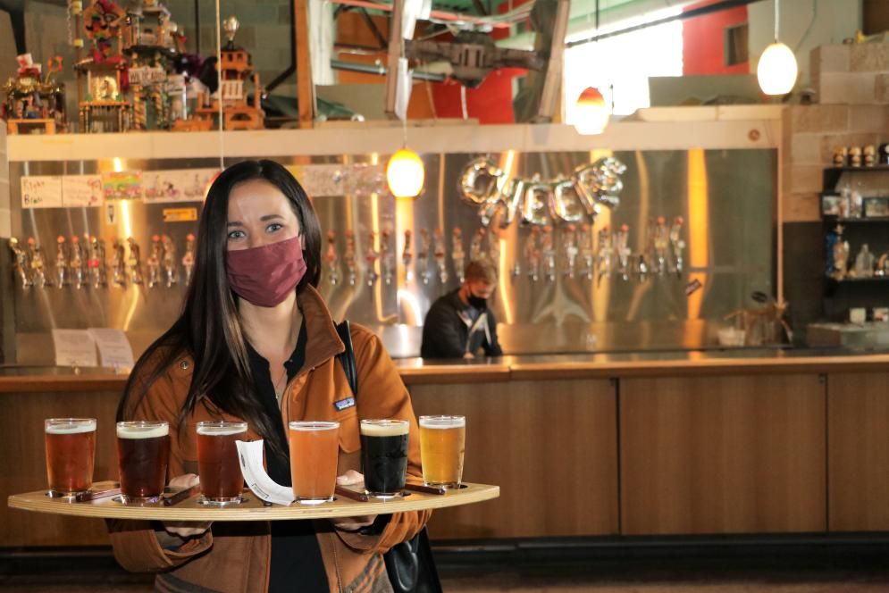 Woman with beer flight at Right Brain
