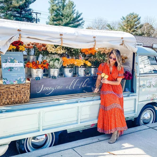 Megan Taylor stands with her VW converted Bus, JoJo the Peaceful Petals Flower Truck.