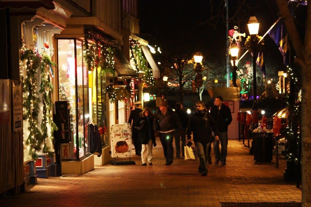 People Holiday Shopping at Night