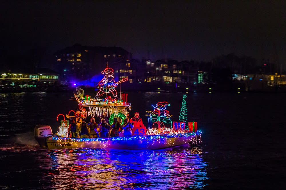 Boat Filled with Christmas Lights at Night
