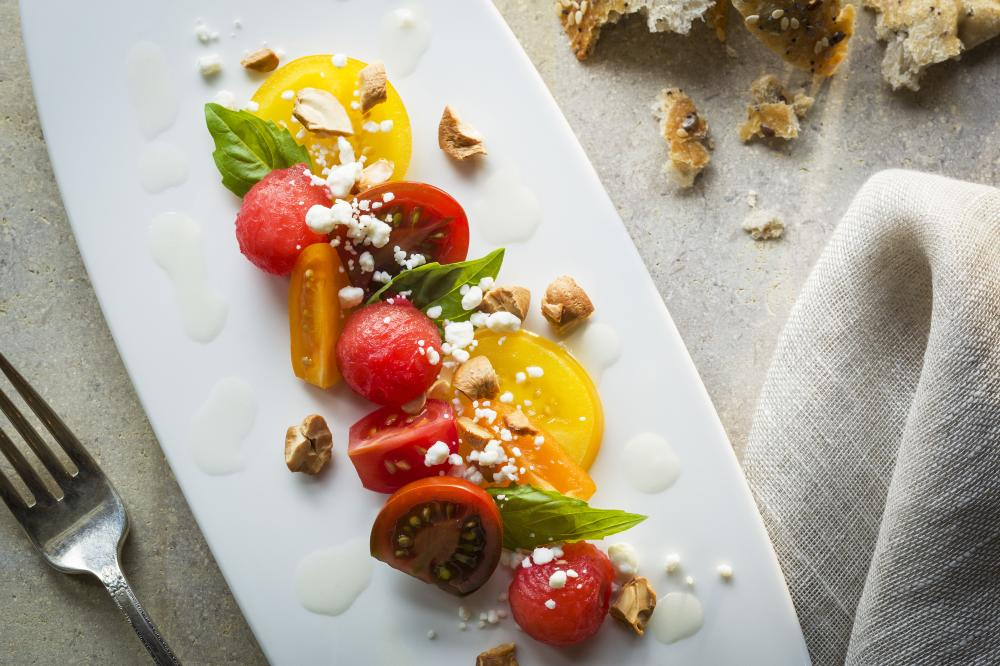 Garden Tomato and Watermelon Salad with nuts basil and feta cheese from Lake Austin Spa Resort in Austin Texas