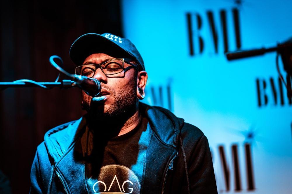 Austin musician Jake Lloyd singing at BMI showcase in Austin Texas