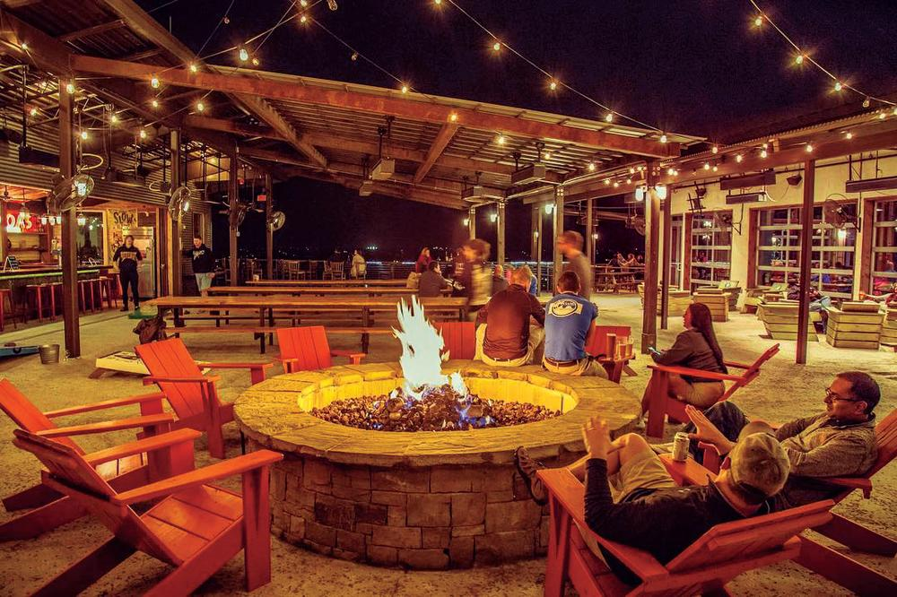 fire pit at night at Oasis Texas Brewing Company in austin texas
