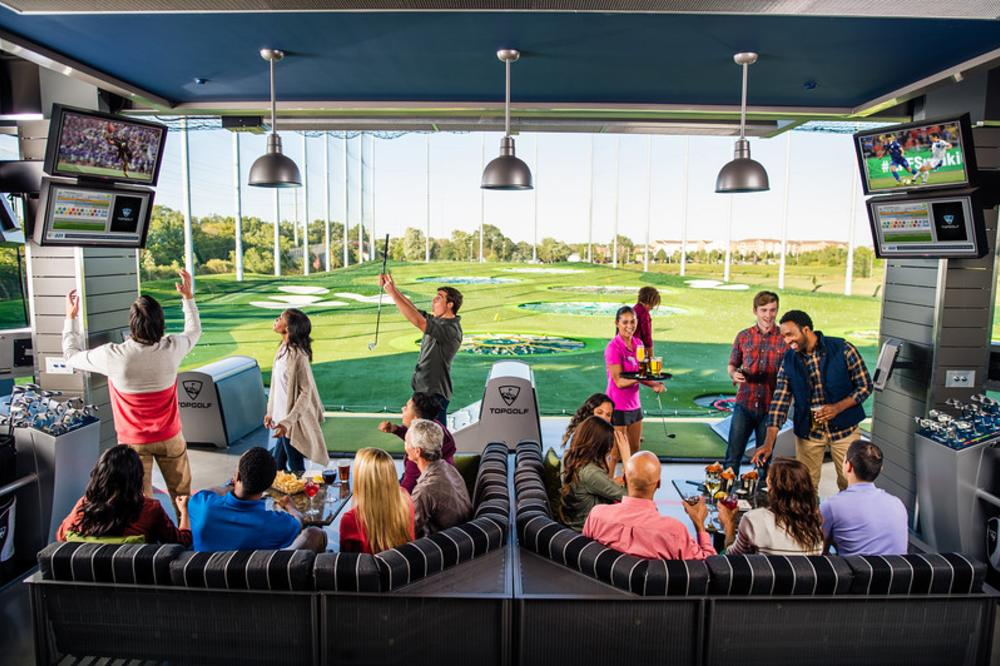 Group of enjoying all that TopGolf has to offer