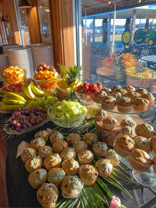 Continental breakfast with muffins and fruit on a table from Joe Huber's Brunch