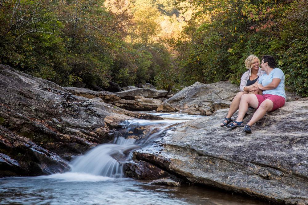 A couple enjoys a scenic cascade