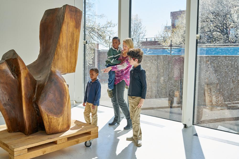 A family explores an exhibit at the Asheville Art Museum