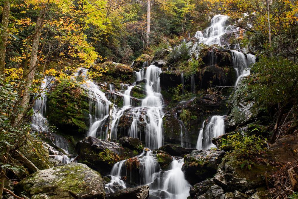 Golden autumn leaves frame Catawba Falls near Asheville, NC
