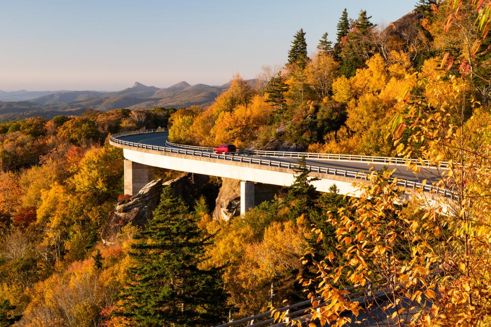 The Linn Cove Viaduct dressed in fall color just after sunrise