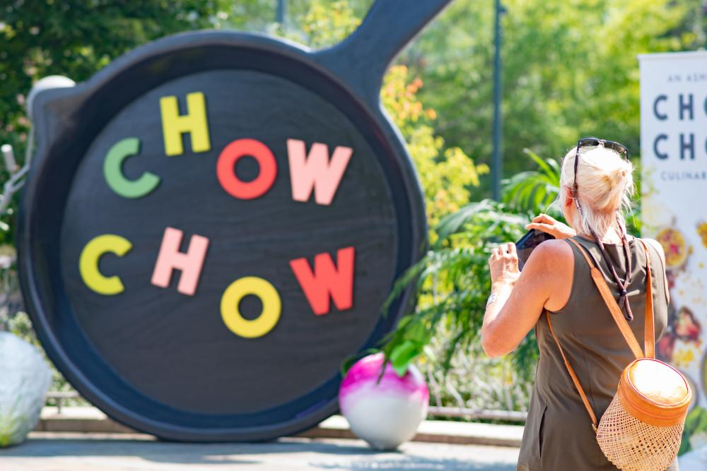 A woman takes a picture at the Chow Chow culinary celebration in Asheville, NC