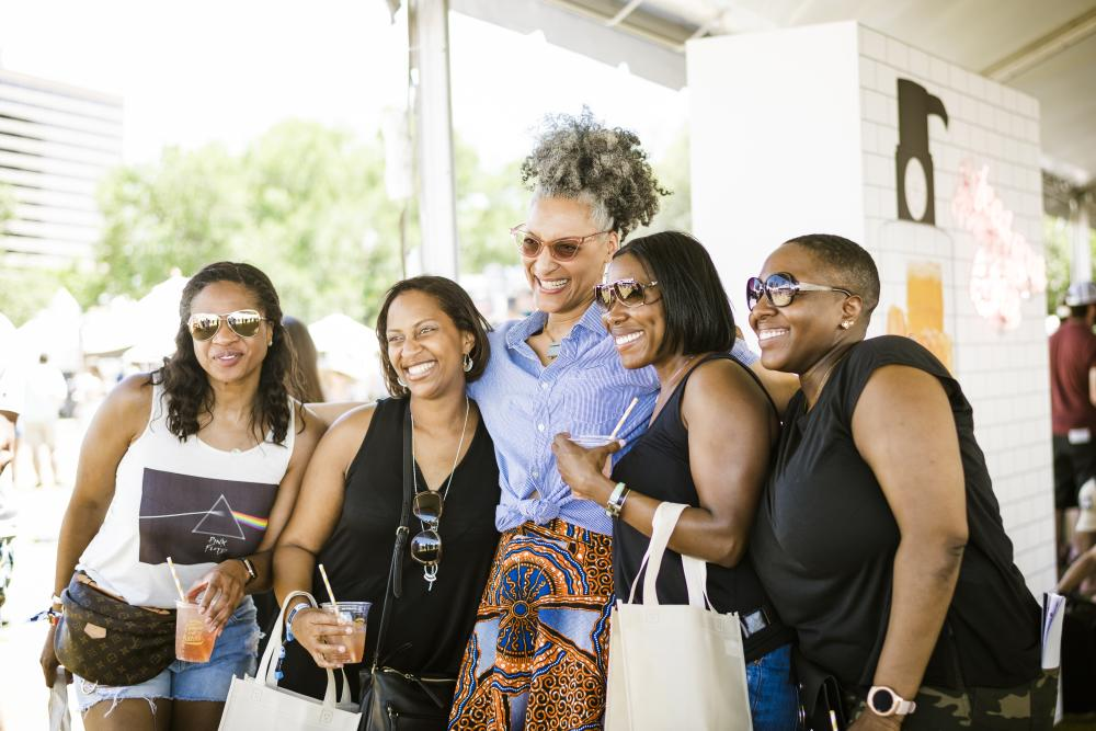 Four women pose with chef at Austin Food and Wine Festival