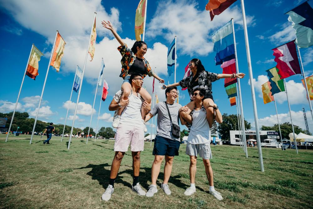 A group of people in front of flags at ACL Austin City Limits Music Festival in Austin, Texas