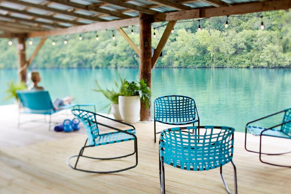 empty chairs on covered Boat dock on Lake Austin at lake austin spa resort in austin texas