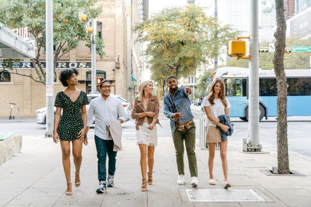 Group of friends walking through 2ND Street District in downtown Austin Texas