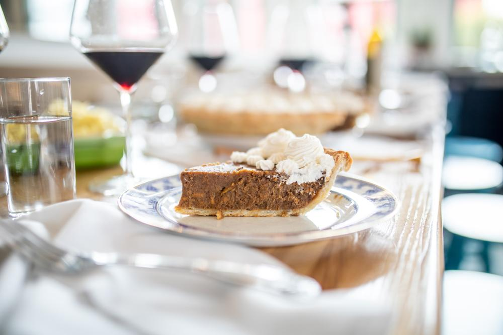 slice of pie and glass of wine at Colleens Kitchen in Austin Texas