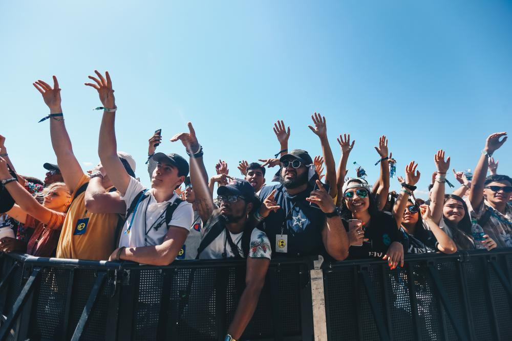 Crowd members wave their hands during a show at JMBLYA music festival in Austin Texas