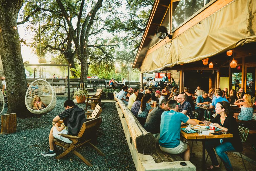 people dining on the patio at Loro in austin texas