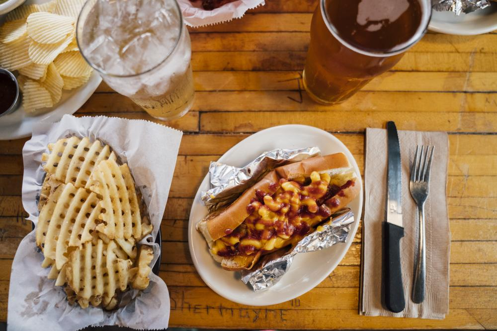 Bratwurst waffle fries and beer from Scholz Garten in Austin Texas
