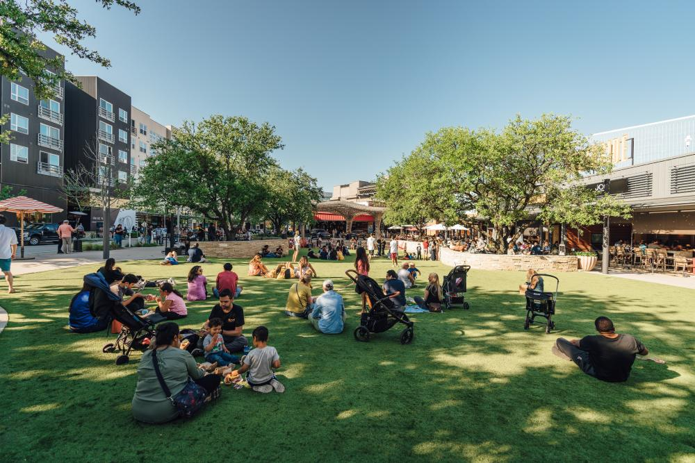 people picnicking on the Northside Lawn at the Domain NORTHSIDE shopping area