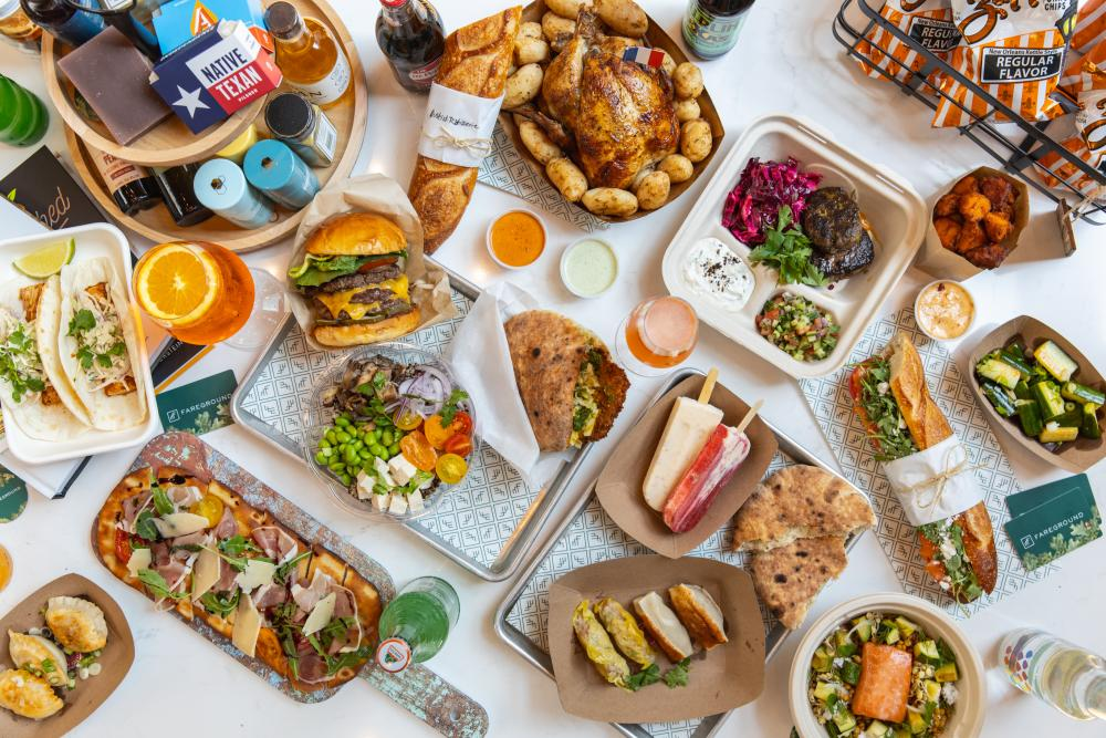 Overhead view of various dishes and beverages from Fareground's food vendors