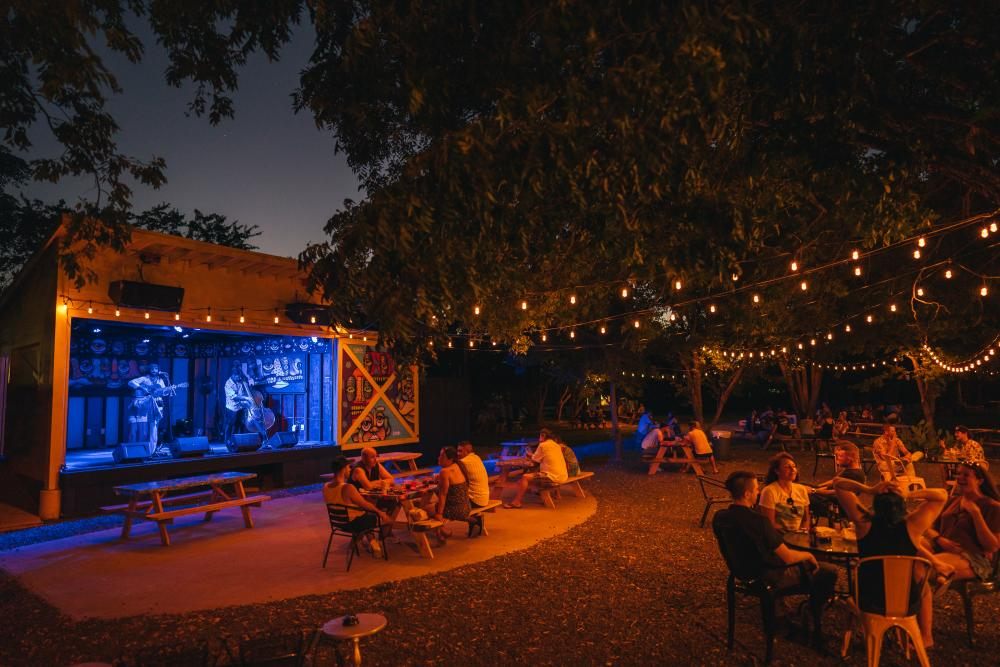 Band performs on outdoor stage at Far Out Lounge in Austin Texas