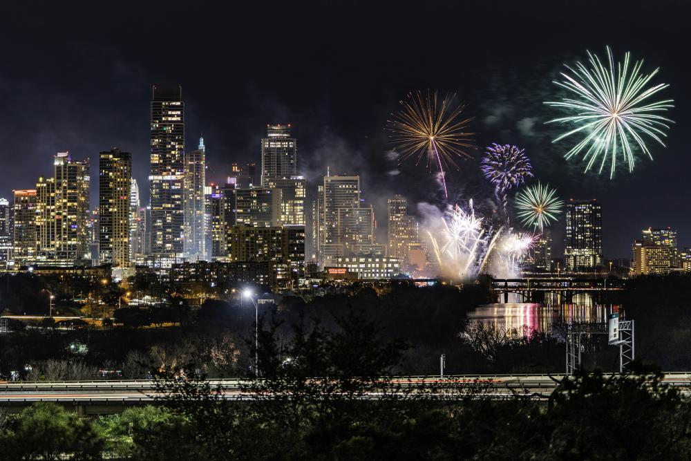 Fireworks over the downtown Austin skyline at night