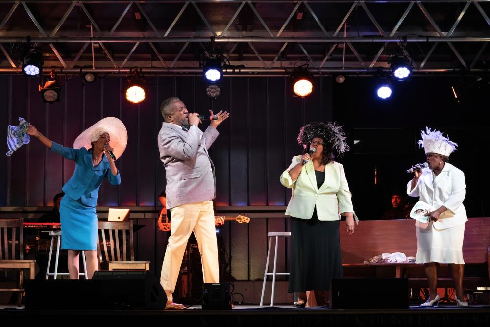 Four performers sing at the Gospel Down By The Riverside show at ZACH Theatres Songs Under the Stars Series in Austin Tx