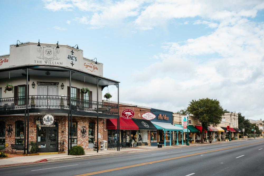 Photo of shops in downtown Boerne, on the Hill Country Mile. Shops include Jac's, Cypress Grille, The Alley on Main, Ella Blue and others