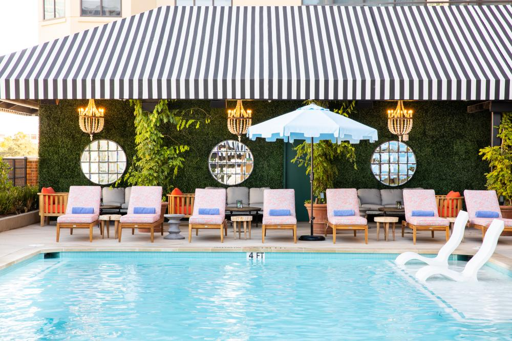 Pool and poolside chairs at Hotel Zaza In Austin, TX
