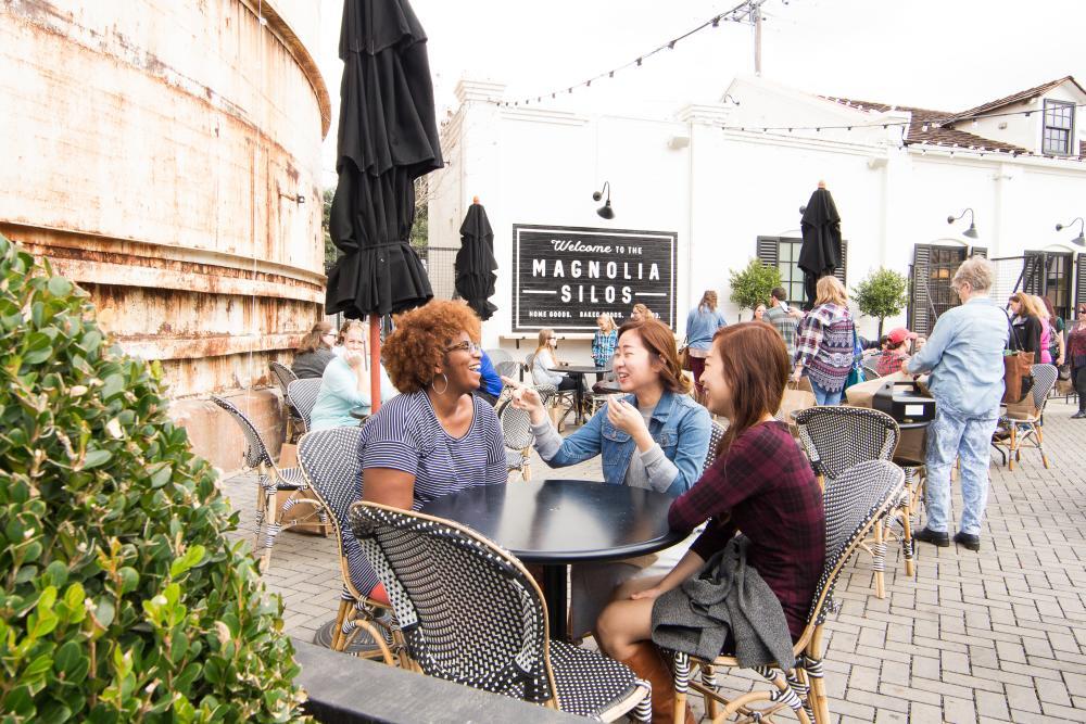 Women sitting together around table on Magnolia Silos patio in Waco Texas