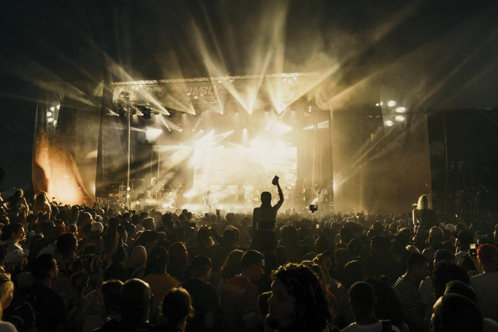 band on stage at night with crowd at JMBLYA music festival Austin