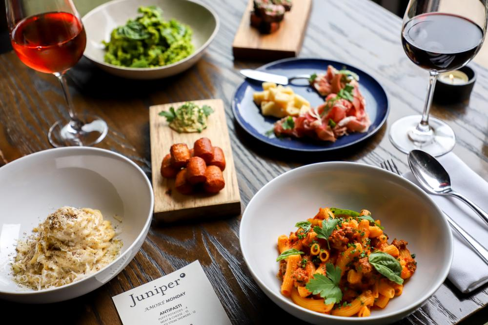 pasta dishes and wine from Juniper restaurant in Austin Texas