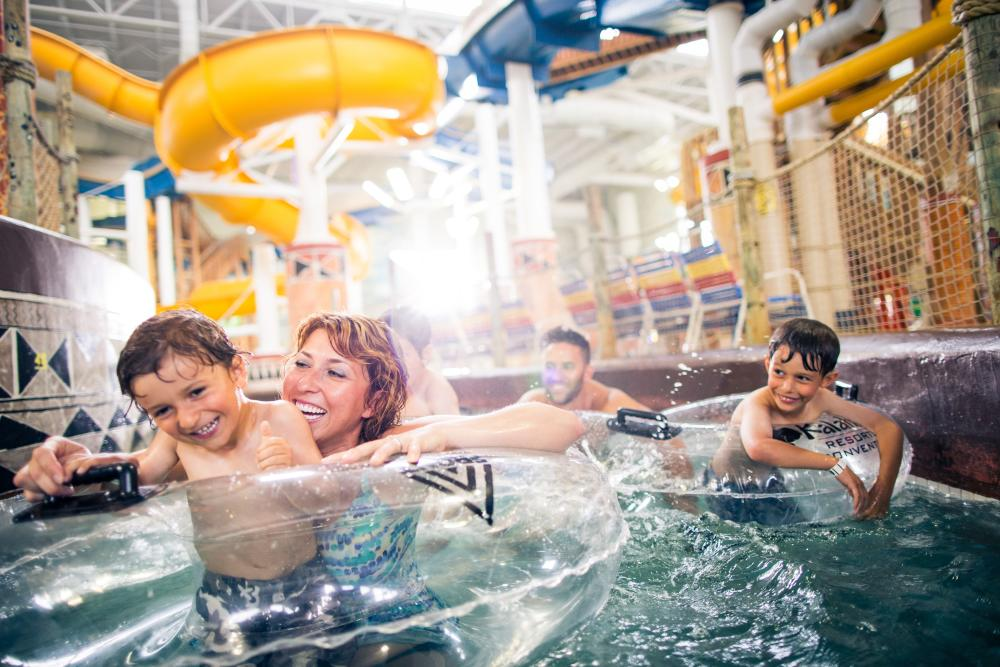 Family swimming in the Lazy River at Kalahari Resort in Round Rock Texas