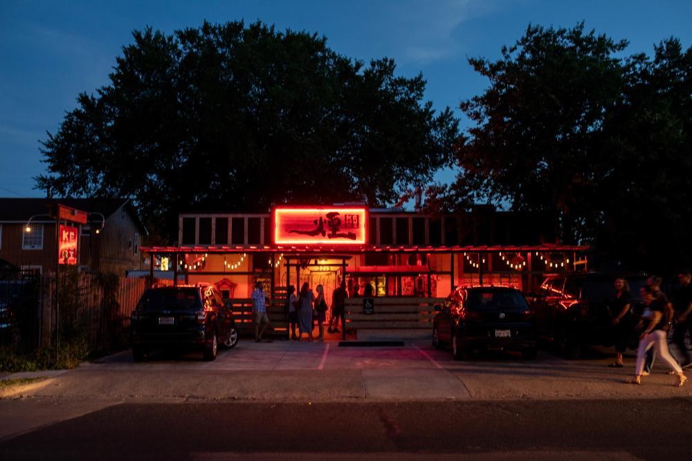 Exterior of Kemuri Tatsu ya restaurant at night in Austin Texas