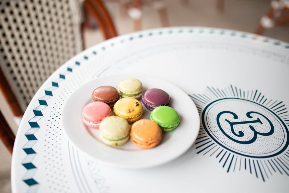 Colorful Macarons on a table at Bakery Lorraine