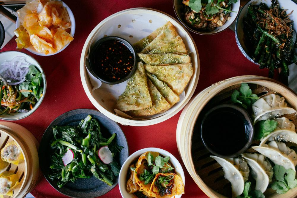 Multiple menu items and dishes from Old Thousand in Austin Texas