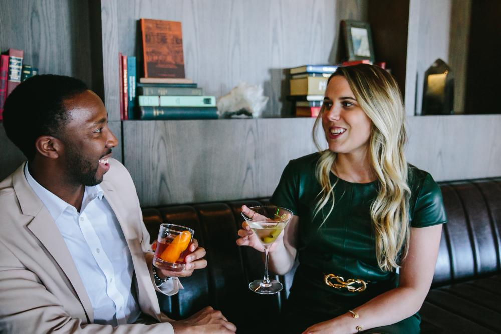 Man and woman drink cocktails at Omni Barton Creek Resort and Spa in Austin Texas