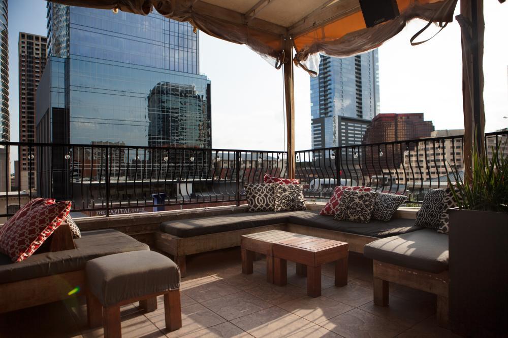 Rooftop patio at Speakeasy bar overlooking dowtnown Austin