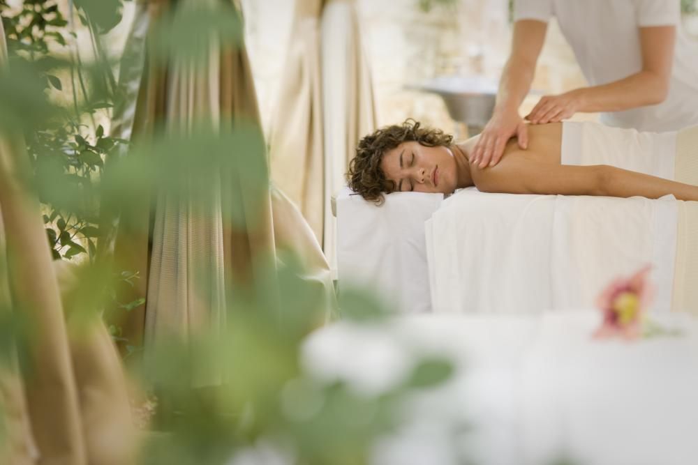 Woman receives massage in Outdoor Treatment Space at Lake Austin Spa Resort in Austin Texas