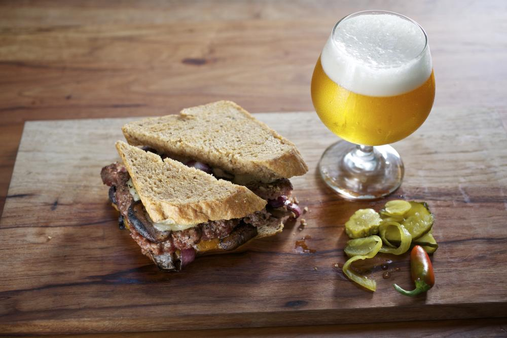 Dai Due Patty Melt with beer in tulip glass