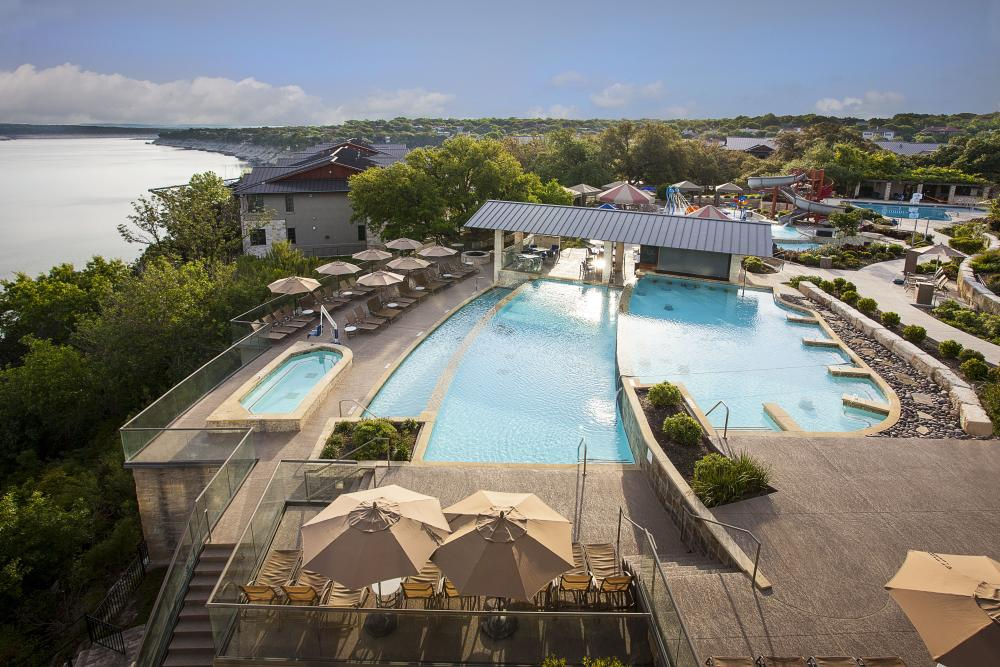 Aerial photo of the pool complex overlooking lake travis at Lakeway Resort in Austin Texas
