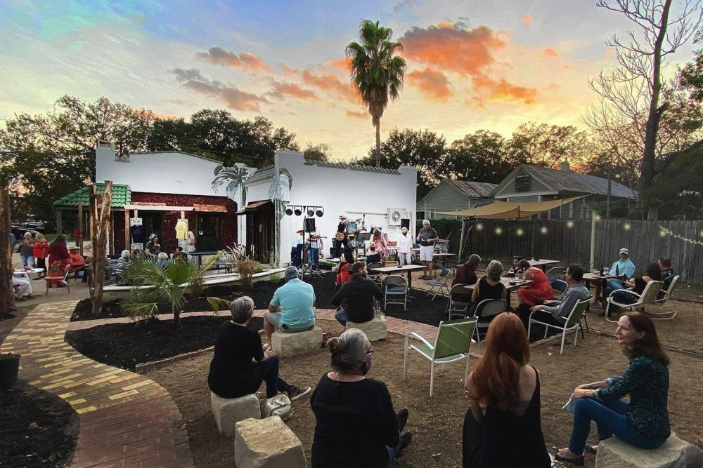 Rio Social House patio with live music at sunset in Smithville Texas