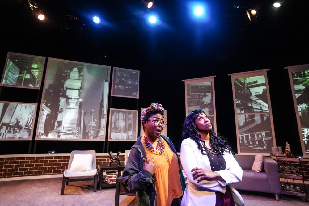 Two female actors on stage during a performance of Single Black Female at Ground Floor Theatre