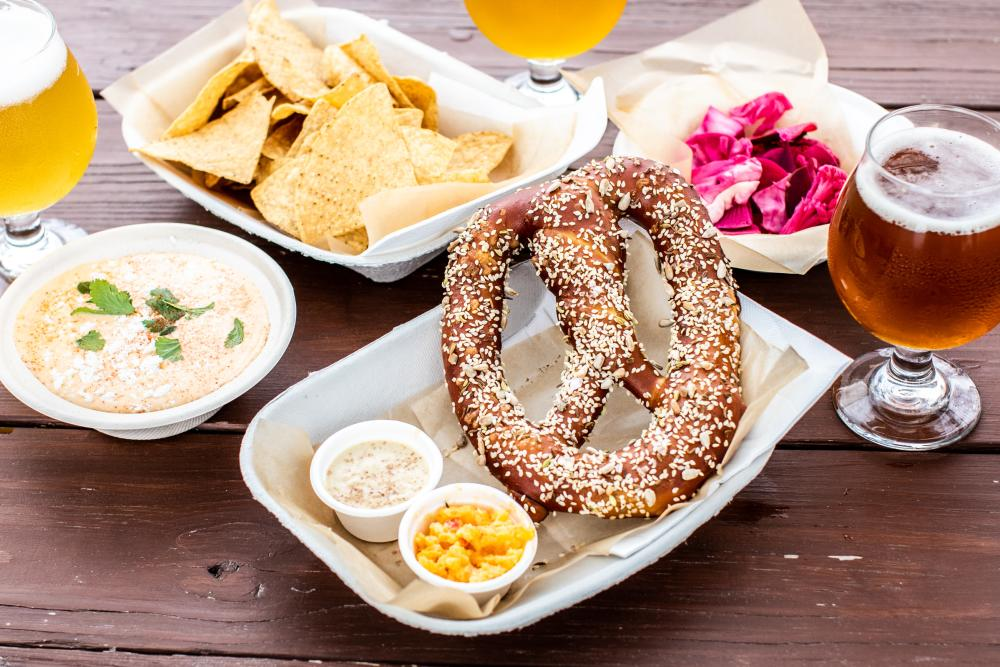 pretzels and queso and beer from Roughhouse Brewing in San Marcos Texas
