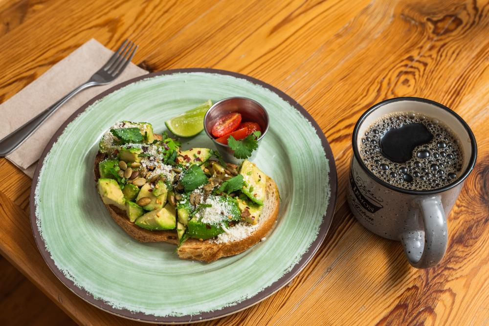 Avocado toast and coffee at Sweet Lemon Kitchen in Georgetown TX near Austin