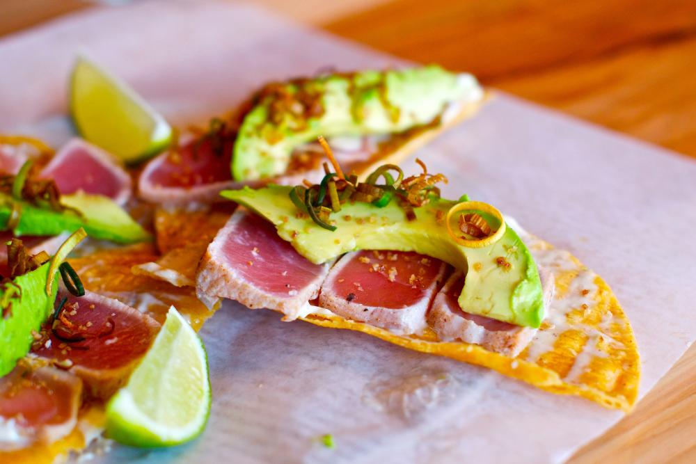 Tacos with avocado and lime wedges Taco Flats
