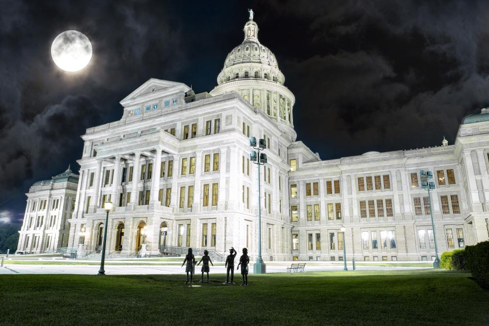 Texas Capitol building under a Full Moon for Austin Ghosts walking tour